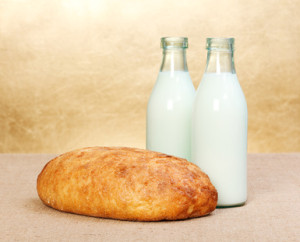 Whole bread and two milk bottles