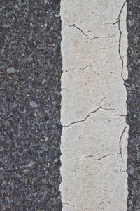 asphalt road with marking lines and tire tracks