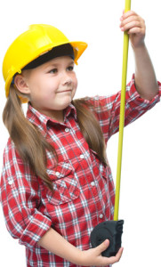 Girl as a construction worker with tape measure